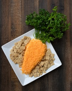 Carrot Shaped Cheese Spread With Parsley Garnish And Triscuit Crackers