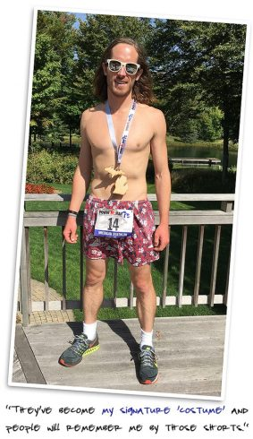 "Dietrich Bronner in his signature ""costume"" running shorts with Power Man race bib."