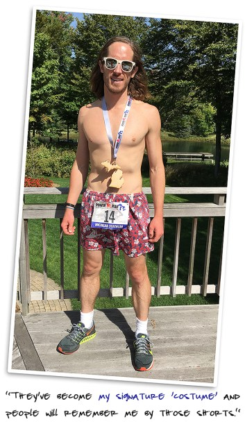 """Dietrich Bronner in his signature """"costume"""" running shorts with Power Man race bib."""