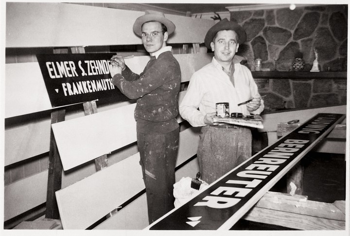 A young Wally Bronner, painting signs in his parent's basement.