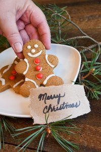 Gingerbread Cookie With Red Hot Buttons And Merry Christmas Hand Written Sign