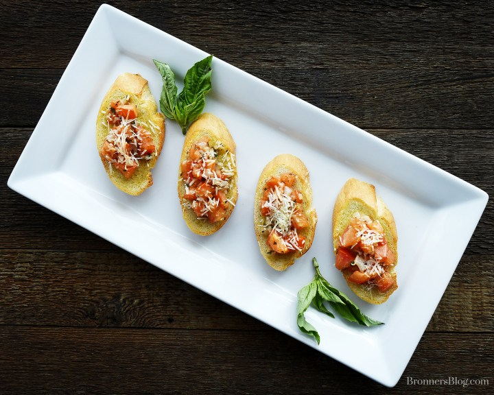 Finger Food, Appetizer Platter With Bruschetta Bites And Basil Garnish.