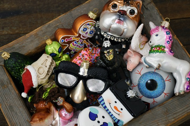 A box full of unusual, wacky, whimsical Christmas ornaments.
