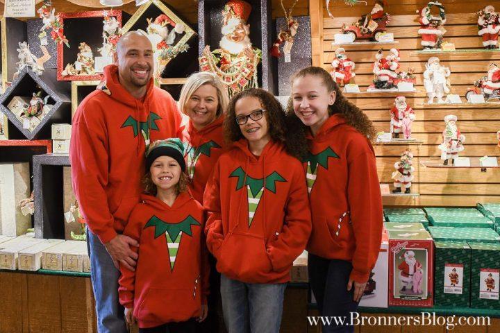 The Jordan Family smiles in their Bronner's Elf Sweatshirts.
