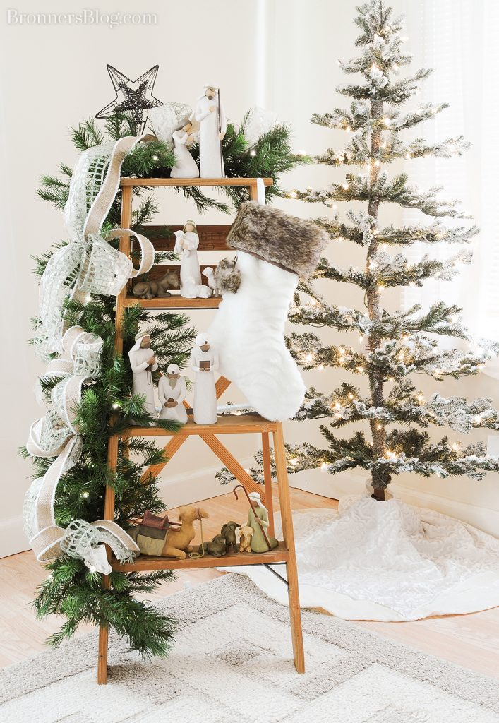 Christmas home decor ideas; Willow Tree nativity on display on a ladder decorated with garland.