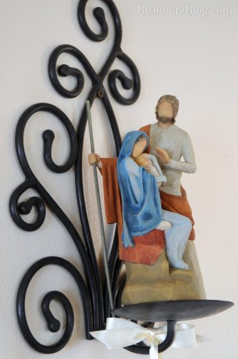 Willow Tree Holy Family Figure on display on a candle sconce.