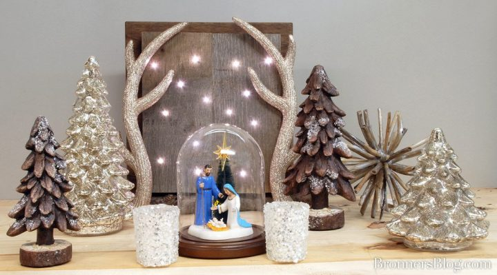 Bronner's exclusive Department 56 Nativity accessory piece in a glass cloche dome with walnut wood base.