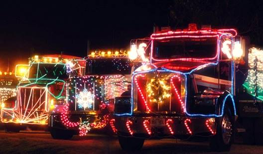 lighted and decorated semi-trucks lined up for Christmas light parades