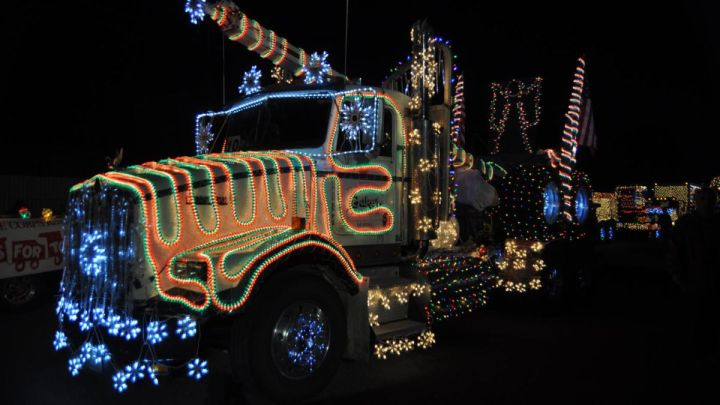 semi-truck cab and trailer decorated with lights for Christmas light parades
