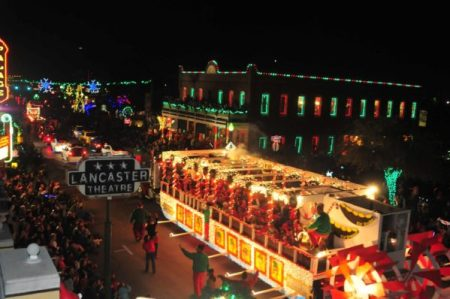 street scene & lighted parade route in Grapevine Christmas parade