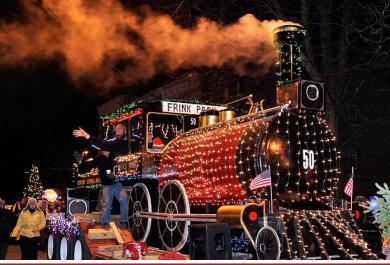 lighted train engine float puffing away in Christmas parade