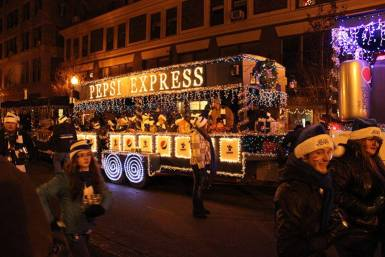 lighted Pepsi Express train car is pulled in Christmas parade in New York