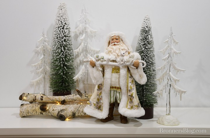 Jim Shore Possible Dreams Santa with decorative trees mantle display.