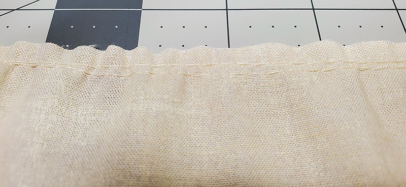 baste stitch two rows at skirt