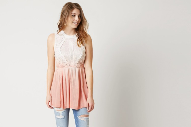 Women in Gimmicks Pink Dip Dye Top, Mid-Rise Destructed Jeans, and Strappy Block Heels.