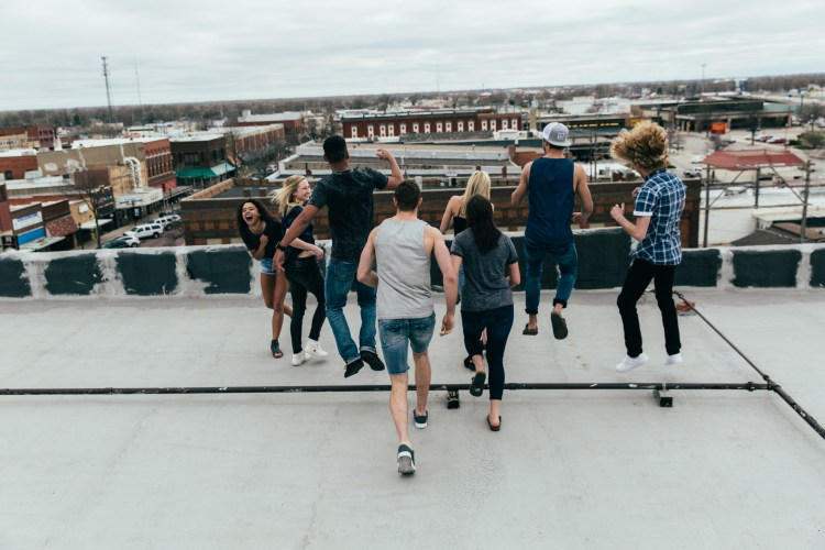 Group of people overlooking the rooftop.