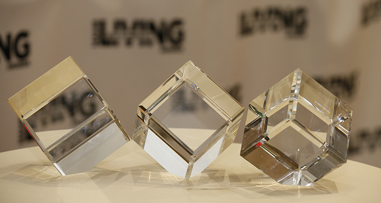 Three clear cubes sitting on a table