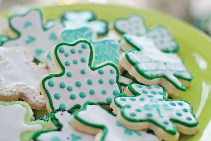 green and blue clover shaped cookies on plate