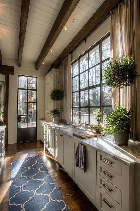 White Kitchen Lined in Rustic Timber