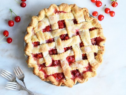 basic-cherry-pie-with-cherrys-and-forks-on-table