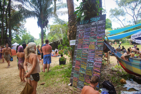 Village Stage schedule (Photo by Zac Cirivello)