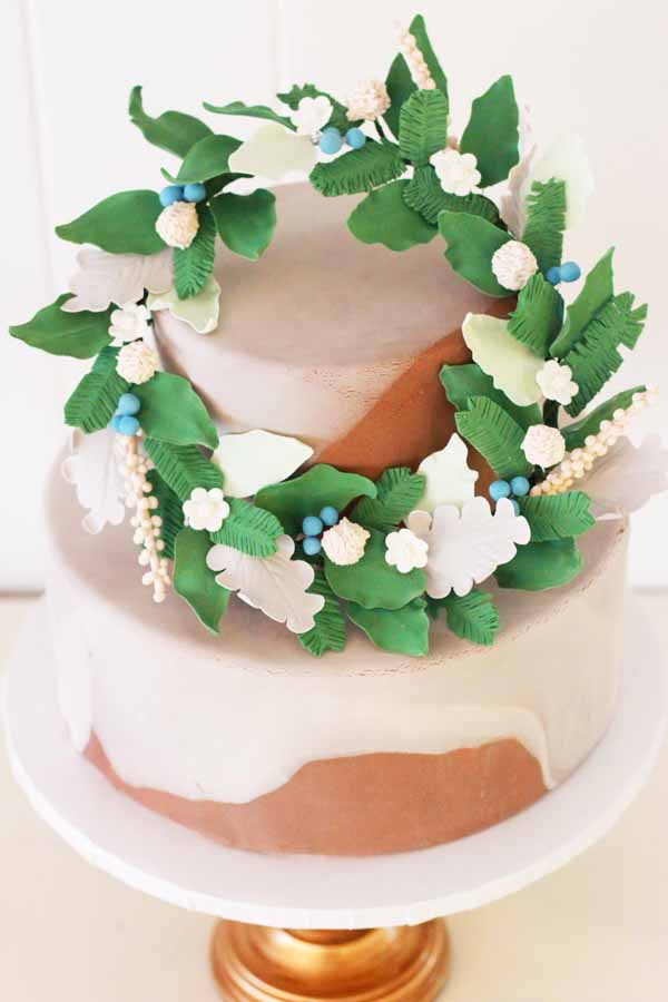 marble tiered cake with sugar flower wreath