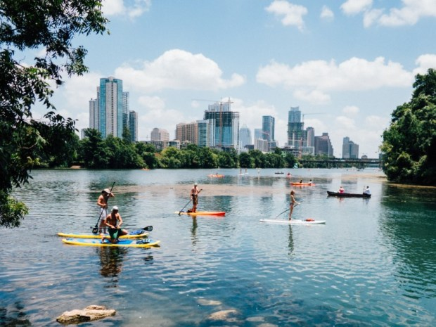 best inflatable paddle board - on a lake near the city