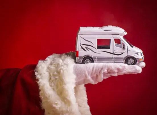 Santa's Hand Holding an RV Camper