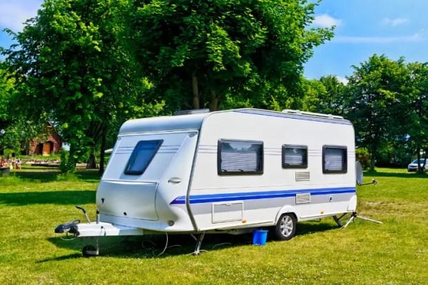 travel camping trailer setup at a lake cabin