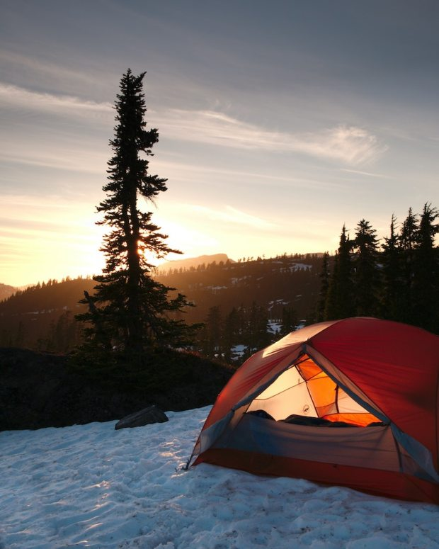 using a tent heater while camping in the mountains in winter