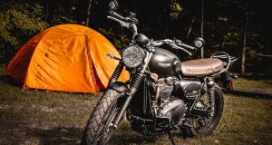 motorcycle camping gear next to a tent