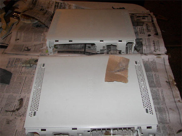 Prepping the surface of an XBox 360 to get wrapped in carbon fiber
