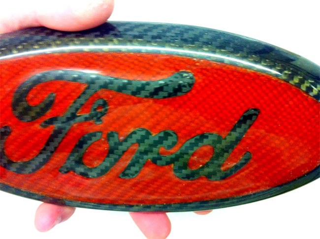 Close up of carbon fiber Ford emblem