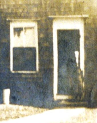 Kitchen door of the farmhouse around 1920 - the child in the doorway is possibly my mother, Janet Hall Crump at age 2