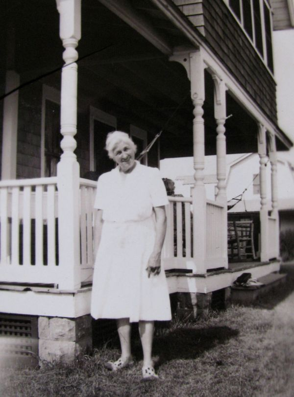 Ellen Hall Norton in front of the cottage, photo courtesy of Margy Norton Campion
