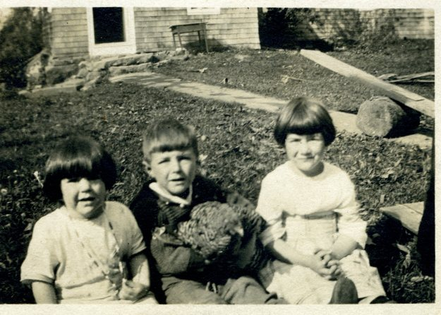 Janet, Francis, and Lydia Hall, 1921 - Francis holding a chicken and wearing a hand-knit sweater