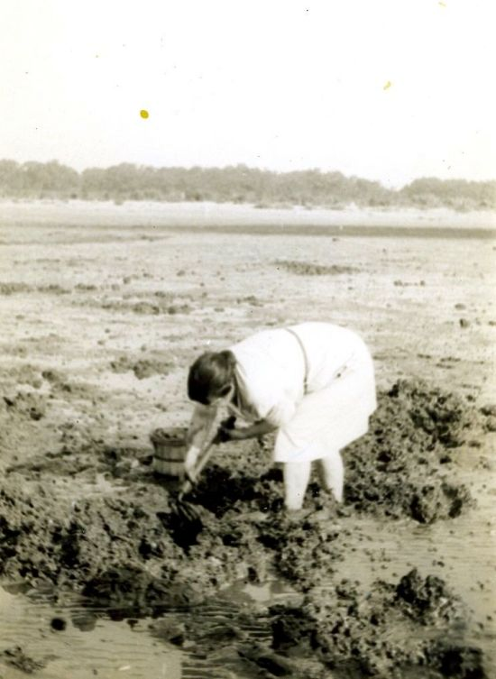 Agnes Biggs Hall digging for clams
