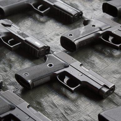 several handguns on black table