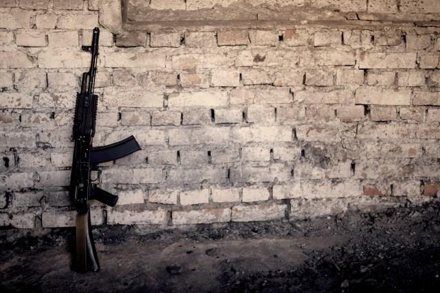 AK-47 Against brick wall
