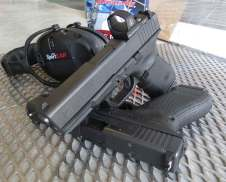 Glock 19 MOS pistol over a Glock 17 MOS with Sport Ear muffs