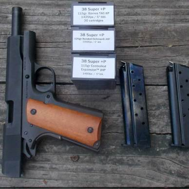 1911 pistol with 3 boxes of ammunition and two empty magazines
