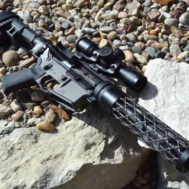 Assembled AR-15 pistol on bed of rocks