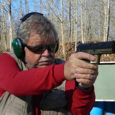 Bob Campbell shooting the Arex REx Zero FDE pistol front