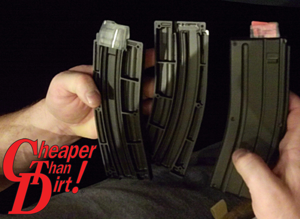 Caucasian man holding Black Dog Machine AR-15 .22LR Magazines