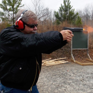 action photo with flames shooting from the muzzle of a handgun