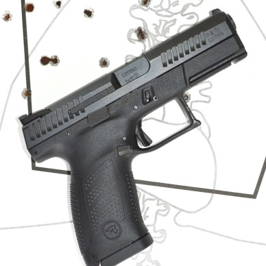 CZ P10-C pistol right side over a used paper target