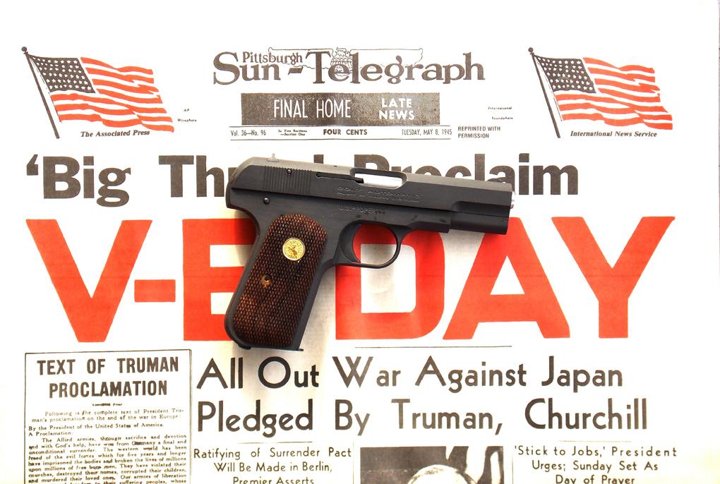 Colt 1903 on Sun Telegraph V-E Day news headline