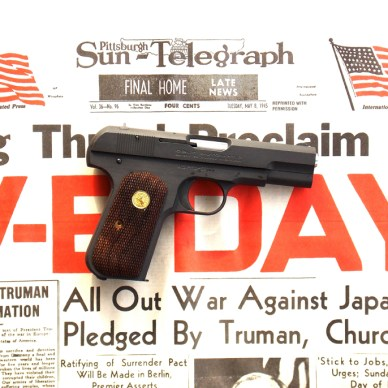 Colt 1903 on Sun Telegraph V-E Day news headline