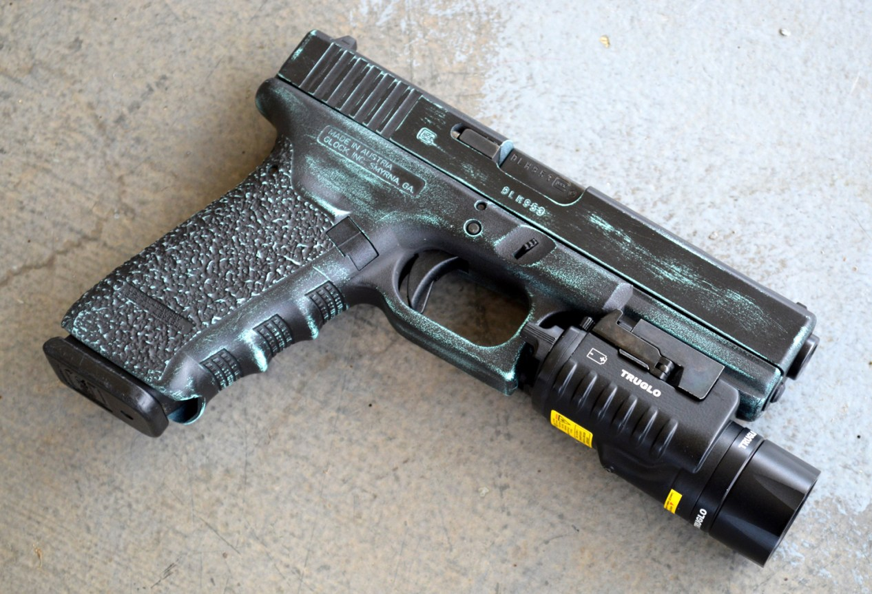 TruGlo light mounted to the rail of a Glock