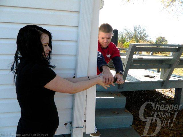 Boy snatching away a girl's revolver